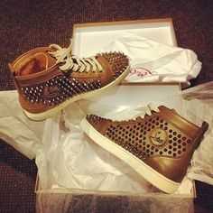 .louboutin hightop studded sneakers