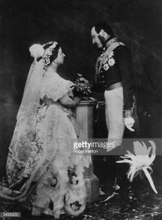 Queen Victoria (1819 - 1901) and Prince Albert (1819 - 1861) in a re-enactment of their marriage ceremony. Prince Albert is in military uniform and is wearing his medals.