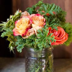 Warm coral color roses mixed with scented geranium leaves.  http://rogersgardens.com/outdoor-gardens-garden-rooms/