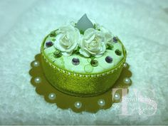 """Directions:  So here is what you will need to make this cake...marvy scallop circle punch, the I Top punch (is that what it's called??), one tea light, 5 small roses, 5"""" of ribbon, a cardstock strip 1/2"""" wide, 5"""" long, adhesive"""