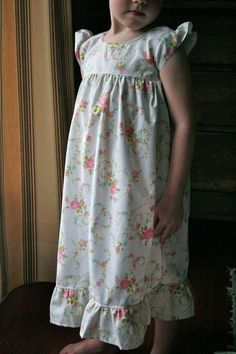 Making little girl's nightgowns from vintage pillowcases and sheets.