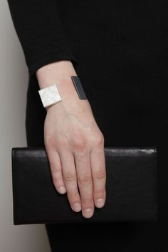 """Bande des Quatres:Eames Bracelet. """"Bracelet is composed of a scratched sterling silver rectangle and a sandblasted oxidized sterling silver square. Band is matte sterling silver."""""""