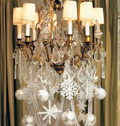 For a winter-white celebration, decorate by dangling white ornaments from silver ribbons