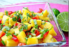 MINTY MANGO SALSA  SKINNY RECIPE   1 large ripe mango, peeled and diced  1 medium sweet red pepper, diced  1 (4 oz) can chopped green chilis  1/4 cup chopped green onions  1 Tbsp lime juice  2 tsp. minced fresh mint leaves  1/4 tsp. ground ginger  Tortilla chips (optional)
