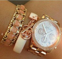 Bracelets, added with a watch? A must! I love it when people do this, it's really cute and it adds more style!