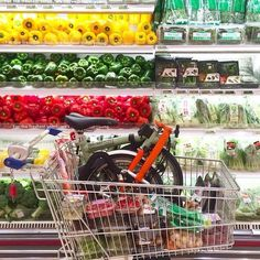 """Have you tried doing grocery shopping with your Brompton? If you aren't doing major grocery shopping, a folding basket will do too! A case of """"Have B Will Shop"""". #brompton #mightyvelo #shopping #colours"""