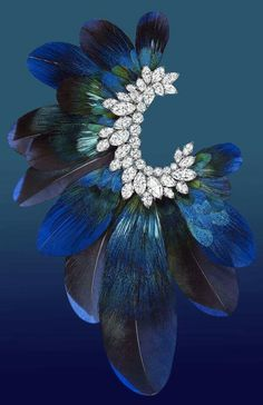 The brooch portion of Harry Winston's 'Ultimate Adornment TimePiece'.  18K white gold, platinum, peacock and duck feathers together with a range of variously cut diamonds...