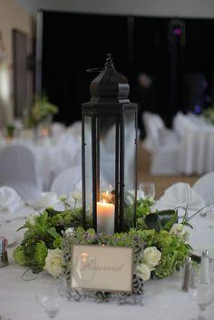 loooove these centerpieces, not gaudy or expensive   Read more - https://www.stylemepretty.com/georgia-weddings/jekyll-island/2011/08/31/jekyll-island-club-wedding-by-sara-d-harper/