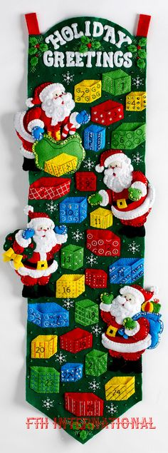Bucilla ~ Santas Advent Calendar ~ Felt Christmas Home Decor Kit #86685  New Release for Early 2016  There are 4 different Santas busy filling the 25 pockets on this advent calendar with different little treats for every day from December 1st right up to Christmas Day. Each pocket is designed to look like a gift wrapped present.  This advent calendar is sure to draw lots of attention as it shines and brightens your holiday decor with all the glistening sequins and beads that decorate the…