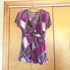 Cute short sleeve top This is a brown, white, pink, green, purple- lots of colors- short sleeve top! Great with a tank underneath and a blazer over for work! Ties in the back as seen in pic. Tops Blouses