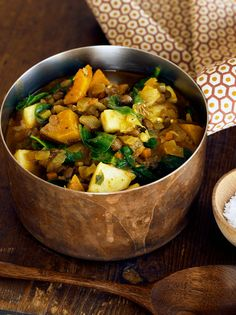 Curried Lentil, Squash and Apple Stew - NYT Cooking: Infused with curry spices and chock-full of wilted spinach, butternut squash and sweet chunks of apple, this unique lentil stew is fragrant and flavorful beyond belief. Curry Stew, Lentil Stew, Lentil Curry, Vegetarian Thanksgiving, Thanksgiving Recipes, Winter Recipes, Happy Thanksgiving, Vegetarian Recipes, Healthy Recipes