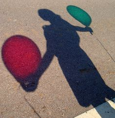 Shadow holding balloons