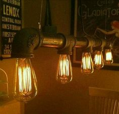 Industrial light made from old gas pipe and Edison bulbs.
