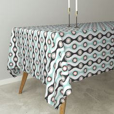 Ikat Stringed Beads Black Mint Coral on Bantam by wickedrefined | Roostery Home Decor, You can also get this fabric from my spoonflower shop. #roostery #tablecloth #homedecor #ikat #simple #mint #coral #black #green #orange #modern #stripes #fabric