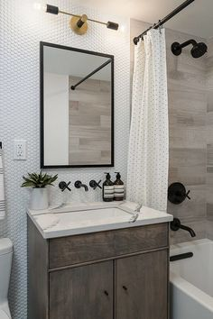 These intricate tiles give a minimalist yet modern look to this bathroom. We're getting industrial theme vibes, with the black taps and frames, matched with the rustic wood vanity. City Bathrooms, Large Bathrooms, Modern Bathroom, Bathroom Ideas, Bathroom Designs, Small Tub, Penny Tile, Tub Shower Combo, Wood Vanity
