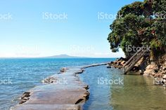 Concrete Causeway from Mairangi Bay, North Shore City, Auckland, NZ royalty-free stock photo Deep Photos, North Shore, Auckland, Image Now, New Zealand, Concrete, Coastal, Royalty Free Stock Photos, Led