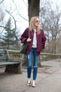 trending: the varsity jacket - oversized plum colored varsity jacket worn with ripped skinny jeans + red sunglasses and flats