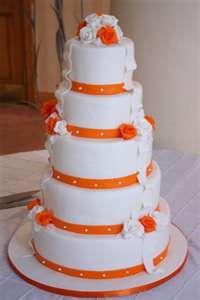 5 teir white and orange wedding cake