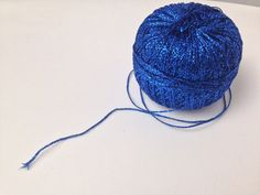 This Royal Blue Metallic Yarn is made by 90% Lame but is still enough soft and pleasant to the touch. This is due to the overhead structure of the yarn. Used for decoration items, scarves, wraps, bags, etc. but you can make effekt crochet tops and shrugs also. Metallic Yarn, Sparkles Glitter, Crochet Hook Sizes, Crochet Tops, Needles Sizes, Decorative Items, Royal Blue, Scarves, Winter Hats