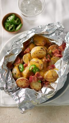 This loaded potato foil pack recipe is sure to be your new go-to side for both weeknight dinners and backyard bashes, any time of year! To make in the oven, place packs on cookie sheet and bake at 375°F 40 to 45 minutes or until potatoes are tender.