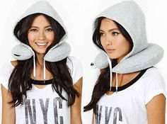 Hooded travel pillow to block out the world/plane ($25).   21 Things Every Traveler Wishes They Owned