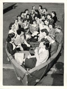 1943- Female workers at California Shipbuilding Corp. shown taking their lunch break in a lifeboat theat is ready to be attached to new Liberty ship ~