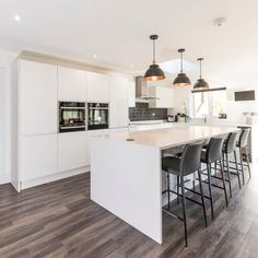 Installed October 2017 This is a lovely kitchen produced by one of our kitchen partners Ktchns Ltd. The worktops are Bianco Puro which is our pure white quartz. Gorgeous Kitchens, Furniture, Gray Pendant, Grey Bar Stools, Luxury, Granite, Luxury Kitchens, Home Decor, Bianco