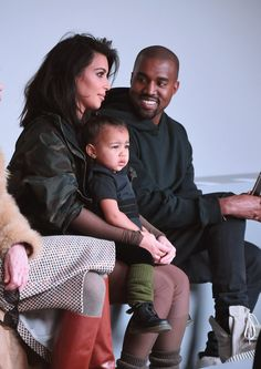 Pin for Later: North West Is Always One Step Ahead When It Comes to Fashion She Got a Front-Row Seat at the Kanye West x Adidas Originals Fashion Show She was on trend in her puffer vest and olive-green leg warmers and even met up with Anna Wintour.