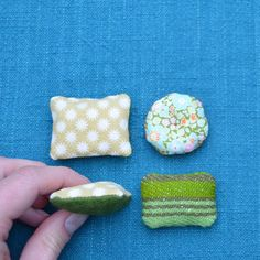 Set of four 1:12 miniature pillows A