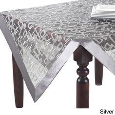 With a dynamic geometric design, this table fabric is available in runner, topper or tablecloth options. The color options are silver or vanilla to perfectly adorn a contemporary table setting.