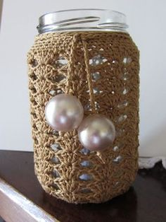 Crocheted put over a jar for a lantern look! This would be so cute or gifts or outside dinner parties