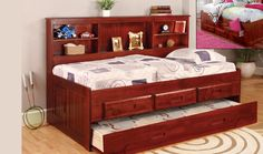 Love to read get tons of book storage in the headboard of the Discovery World Furniture MERLOT Twin Size Bookcase Day Bed.
