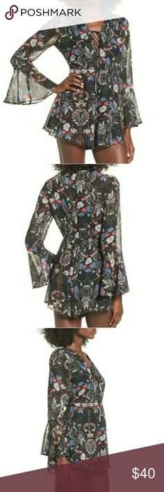❤ JUST IN ❤ Floral Romper It's soooo boho!  Get ready for spring with this chiffon floral romper by Lush. Features bell sleeves and lace-up front. A must-have in everyone's wardrobe. Lush Pants Jumpsuits & Rompers