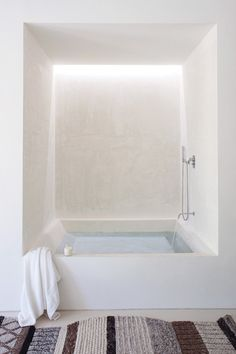 Love the subtle light behind the bath, adding a sense of calmth and repose to the ritual of taking a bath. Renovation/addition to the Gandia Blasco factory in Spain.Photography by Jean-Francois Jaussaud