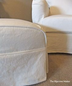 Chair and ottoman slipcovers customer made in heavyweight washed white denim.