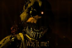 Nightmare Chica. Holy actual crap. Look on her shoulder, though. Creepy sharp toothed cupcake.  I brightened it, and what I could make out was Night. The G was the light from Chica's face.