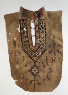 Part of a tunic front with geometric pattern and birds (front)