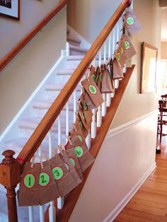 Christmas Countdown: Use brown paper sacks cloths pin them to a piece of rope, hang it up, and put small gifts in each for the kids to receive (: a good idea!