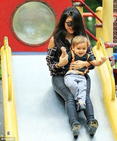 Kourtney and Mason in Central Park. Look at those little suspenders!