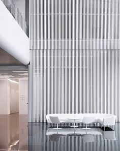 A screen of spray-painted extruded aluminum slats dominates a lobby at Maike Group in Xi'an, China. Most of the complex was a collaboration between Hallucinate Design Office and Interdesign Associates. Photography by Javier Callejas. Interior Design Magazine, Office Interior Design, Office Interiors, Design Offices, Modern Offices, Lobby Interior, Interior Architecture, Commercial Design, Commercial Interiors
