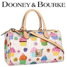 Dooney & Bourke Cupcake Barrel Classic Handbag. It seriously has cupcakes on it. CUPCAKES!