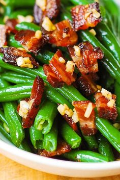Garlic and Bacon Green Beans - Made 5 lbs. for 18 people. Cooked beans 6 mins. in water then added garlic butter to beans in a big casserole dish. Added chopped cooked bacon on top and baked at 350 uncovered for 30 mins. Stirred and served. Yum!