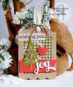 Christmas Tag by Kay Miller. Reverse Confetti stamp set: Winter Words Coordinates. Confetti Cuts: Gift Card Tag Holder, Wreaths, Winter Words, Branch Out, Love Note, Stitched Flag Trio. The 25 Days of Christmas Tags. Holiday Tags.