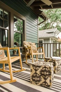 Painted dark green with lighter green accents, a classic Craftsman palette, this home has a natural feel from the front door all the way through to the interior and out to the backyard.