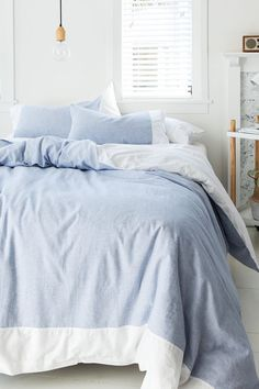 Oscar Duvet Cover Set - Is there a more classic colour combination than fresh white and soft chambray blue?