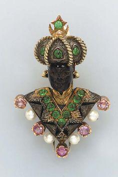 A MULTI-GEM, HARDSTONE AND GOLD BLACKAMOOR BROOCH, BY NARDI  13 cabochon and 2 circular-cut emeralds, 5 circular-cut pink sapphires, 4 cultured pearls