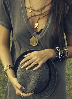 Stacked #bracelets and pendant #necklaces worn with a deep V-neck shirt and Calvin Klein heavy twill #fedora