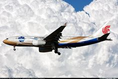 Airliners.net - An Air China special livery A330 on final against amazing clouds at Milan. Matteo Stella