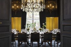 To echo the gilded mood of the dining room's ornate, pre-existing wall sconces, Moinard installed copper-foil screens. A Mathieu Lustrerie chandelier with pendants and black-and-gold wall paneling realized by Atelier Lucien Tourtoulou complete the effect.