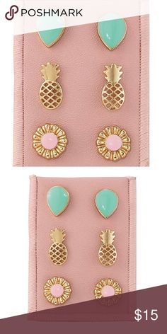 Cute stud earring trio • Includes 3 pairs of pierced studs • Post and bullet clutch • Trio includes: teardrop stud earrings with a faux green stone, openwork pineapples and flowers with a faux pink center stone • Packaged on a pink velvet backing  • Goldtone metal  Super cute!! Avon Jewelry Earrings